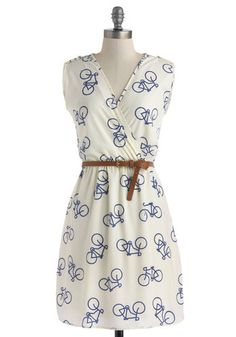This dress is so cute and fun for a summer day. Switch out the brown belt for a bright orange one (not neon orange though) to add a little extra something to your outfit.