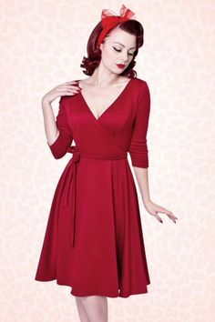 "You can create countless gorgeous looks with this 50s Donna Swing Dress in Red by Heart of Haute!  Dress it up or down, this timeless beauty will never let you down! Beautiful fitted top featuring a sexy V neckline, 3/4 sleeves and a detachable bow tie that accentuates your waist just perfect. From the waist down ending in a semi-swing skirt which hits below the knee with a height of 1.70m / 5'7"". Made from a soft and supple, stretchy dark red fabric for a lovely fit. Vin..."