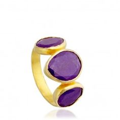 I love this 18 carat yellow gold Sugilite three stone ring from astleyclarke.com