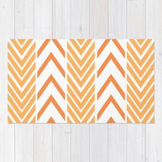 "Floor Rug - Orange and White - Door Rug - Orange Arrows - Bathroom Rug - Original Art - Throw Rug - Orange ZigZag - Made to Order This rug is done with the Orange and White - Arrows/ZigZags  This item is ""MADE TO ORDER""  DESCRIPTION: Premium quality area rugs boast an exceptionally soft touch and high durability.  MATERIAL: 100% woven polyester NON-SKID PAD NOT INCLUDED  SIZES: 2 x 3 3 x 5 4 x 6  CARE: Machine washable  OTHER ITEMS: Most original art/photography available in the fol..."