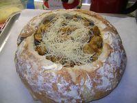 Τηγανιά ψημένη σε καρβελάκι με τυριά.