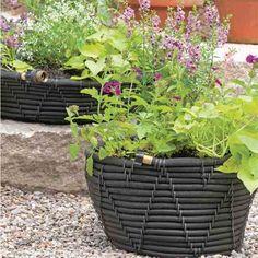 Craft this DIY self-watering garden-hose pot. #watergardening