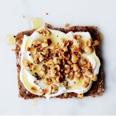 Toast with Greek Yogurt, Hazelnuts and Honey Substitute ricotta for the yogurt or your favorite nut Yum!