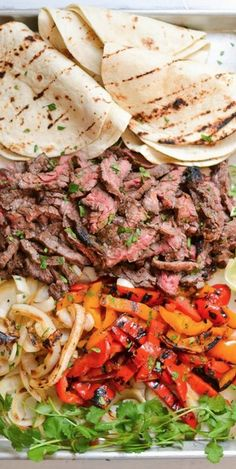 Skirt Steak Fajitas! Yum! The steak is marinated with a soy sauce and lime mixture, grilled to perfection and folded inside warm tortillas with classic fajitas toppings!