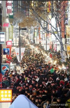 This picture is of Christmas eve in meongdoung. we ususally regard eve is more important than Christmas. as you can see there are lots of people  spending with their people like friends, love , family~!