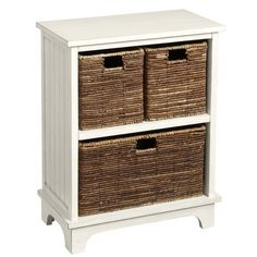 Who says storage has to be a stack of starkness? Our handsome antiqued white wood cabinet features an upstairs/downstairs arrangement of 3 hand-woven baskets for organizing office supplies, craft materials, toys and, say, clutter.