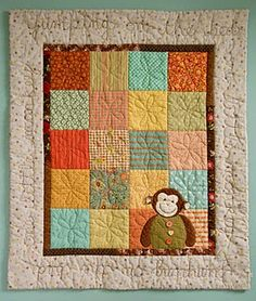 One Little Monkey baby quilt on patchwork pottery
