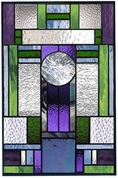 This panel is made with multi textured clear, purples and blue and green glass. Mostly Spectrum glass. It can be modified to fit your color and space requirements. Pricing is based on size as well as number of pieces in a design.