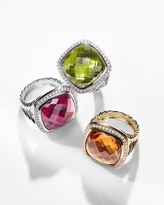 Albion rings in 18k gold with gemstones and diamonds.