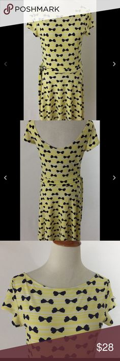 Leota Compass Rose Yellow Bow Print Dress sz M Very good condition. Pull on and stretches. Measures about 16 inches across the chest and 38 inches in length Leota Dresses