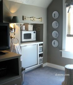 I love the idea of having a mini fridge in the guest room. Stock JUST like a hotel mini bar but without the OUTRAGEOUS prices. The microwave seems like a bit much, but I'm totally down for a fridge in the closet.