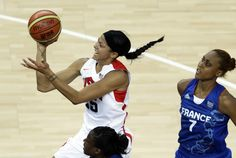 Candace Parker of the U.S. drives to the basket in the women's basketball gold medal game. (Victor R. Caivano/The Associated Press)