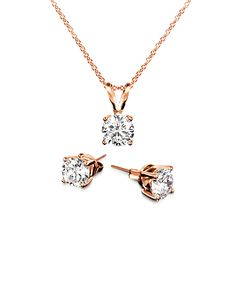Regal Jewelry Cubic Zirconia & Rose Gold Pendant Necklace & Stud Earrings | zulily  . $5.99 Compare at $17.50 Product Description:  Set against radiant rose gold plating, glittering cubic zirconia brighten these studs with casual-glam flair. A coordinating pendant necklace completes the lovely look.      Includes necklace and earrings     Earrings: 6 mm diameter     Chain: 18'' L     Pendant: 6 mm diameter     18k rose gold-plated brass / cubic zirconia     Imported
