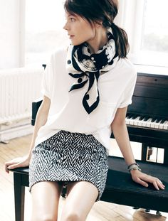 Black and white minimalist outfit. White tee, zigzag skirt and polka dot square scarf. | @andwhatelse