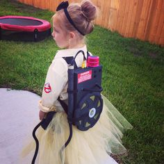 Kids homemade costumes. Female and girls ghostbuster #halloween. Cereal box, bubble gun, frrisbee, pink Bluetooth speaker with theme song. ghostbusters #tutu DIY
