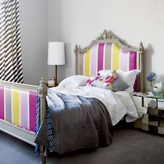 teen girls room with colorful headboard