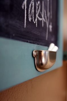 Make your own chalkboard- inverted drawer pull for a chalk holder.  Brilliant.
