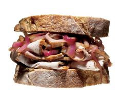 Pork Sandwich with Red-Onion Relish - Sauté red onion slices in olive oil until soft, adding a splash of red-wine vinegar as they cook. Slice roasted pork thinly, layer it on sourdough bread, and top the pork with the onion relish. A little ketchup would help.