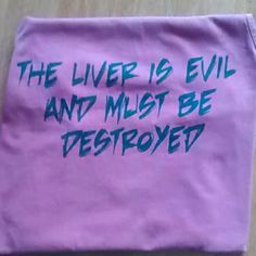 The liver is evil tank top Washed out tank. Red tank top. The liver is evil and must be destroyed is on the back. This item runs large. Comfort colors Tops Tank Tops