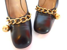 """Smashing late 60's ROSINA FERRAGAMO black leather shoes with stellar ball & chain embellishment on vamp! Made in Florence by the sister of famed Salvatore Ferragamo, these shoes are as well crafted as they are designed. Black leather, leather interior, uppers & soles..metal toe taps. Rounded """"square"""" toe in true MOD fashion....."""