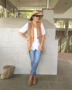 Feeling a little bit country. Love the @bohemian.traders suede waterfall vest in camel from @stylingyou shop. Looks great teamed with a white cotton shirt, blue denim girlfriend jeans and my favourite @frankie4footwear ankle boots. All current .Kept the sun off my face watching soccer wearing @bluebungalow felt hat (last winter ).