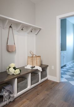 Oak wood floors accent gray walls highlighting a white built in bench fitted wit. Oak wood floors accent gray walls highlighting a white built in bench fitted with cubbies holding s Modern Entryway, Entryway Decor, Entryway Ideas, Small Mudroom Ideas, Rustic Entryway, Entrance Ideas, Mudroom Storage Ideas, Garage Entryway, Modern Entrance