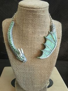 Game of Thrones Khaleesi dragon necklace. Polymer clay, glitter and iridescent acrylic paint accents, Swarovski crystal eyes, adjustable metal necklace chain with clasp. By Beki Ferrari at Salem Collective of Artists and Musicians, Salem Ma