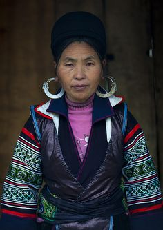 Hmong woman dressed for Tet - Vietnam - Tet , the vietnamese new year is an impoortant moment in the life of the country. In the tribal north, people buy or still make new clothes they will wear the day after the celebration.  The Hmong still do their clothes, and use indigo plants to make the dark blue color.  Photo by Eric Lafforgue