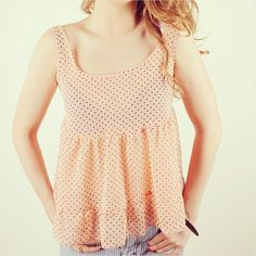 This salmon pink baby doll inspired vest top features small ditsy polka dot all over and two tiers of ruffles at the bottom of the top.A feminine, and delicate piece perfect for slinging over a bikini on hols or for teaming up with shorts and sandals.UK size Small - Medium.Measurements: Length: 23 inches and Width: (from under arm to under arm) 16 inches (all the way around bust and back) 32 inches. This item does not have stretch.If you have any further questions re...