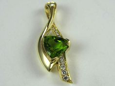 Peridot Trillion Pendent 3.61ct. 14kt. yellow gold. Dia. twt. 0.22ct.