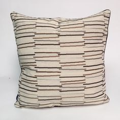 Lava Accent - This decorative throw pillow is retro and sporty in tones of brown, light green and gold with beiges in the background.  Made of very sturdy 67% polyester, 12% Dacron, and 11% cotton, throw this pillow around your den, family room,  and office.  Great for a kids room or dorm room, too.