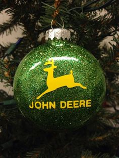"Designed by Bri's Crafts & Things, these fun holiday ornaments are thin, round bulbs filled with lots of sparkle and vinyled with your favorite farm logo - John Deere. Ornaments measure about 3"" in di"