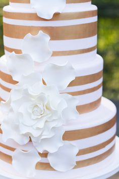 gold striped cake, Love Gives Way collective http://ruffledblog.com/love-gives-way-wedding-shoot #weddingcake #cakes