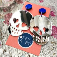 The perfect Halloween earring doesn't exi... These beauties by Beena & Ro come in 4 different designs! ~*~ #beenaandro #skull #skulls #skullearrings #halloween #halloween2021 #halloweenearrings #acrylicearrings #mirroracrylicearrings #handmadejewellery #handcraftedjewellery #handmadeearrings #statementearrings #earringaddiction #earringlove #statementearring #earringstyle #earringfashion #earringdesign #earringobsession