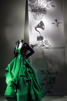 Motorcycle Jacket with the best designer in the world? Yep, that's me. (A Balenciaga jacket over an Oscar de la Renta dress on display in a window of Bergdorf Goodman, early 2011.)