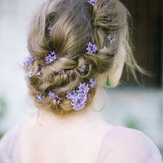 Delicate lilac pinned among this pretty updo ~ we ❤ this! moncheribridals.com