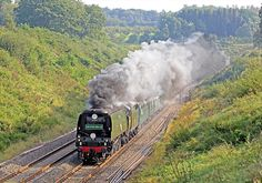 The problem of smoke blow-down with this Class of locomotives is apparent, as ex-SR 'Battle of Britain' Class 4-6-2 No. 34067 'Tangmere' emerges from the tunnel at the top of Whiteball bank with the outward working of the 'Royal Duchy' on Sunday 9th September 2012 (compare with SW9).