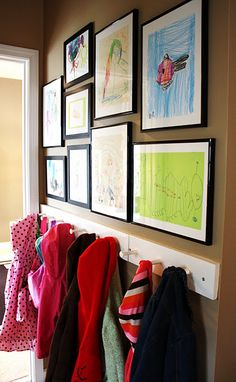 So inspired by this home. Many doable approaches to family design and DIY ideas! School Bag Storage, Artwork Display, Framed Artwork, Hanging Kids Artwork, Display Wall, Kids Coats, School Bags, Childrens Artwork, Childrens Art Display