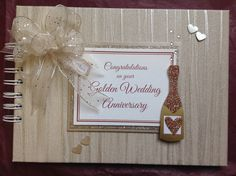 An over-sized bow completes this gorgeous Golden Wedding Celebration Book