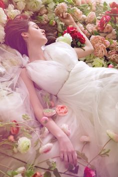 Rosa Perfumada...Lying in her bed of Roses. She has found the treasure that lies at the Rainbow's end; surrounded by Sweet William, for-get-me knots, and crimson shades of velvet rose.