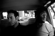 3D and Daddy G in the back of a Tokyo taxi in July 2003. Photo originally published in Word Magazine's October 2003 issue, which featured an in-depth interview with Massive Attack whilst on tour in Japan.