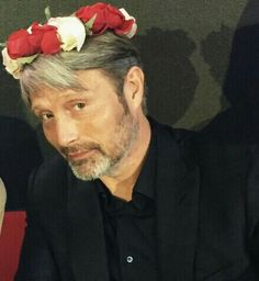 Mads Mikkelsen in a flower crown. This picture is perfection.
