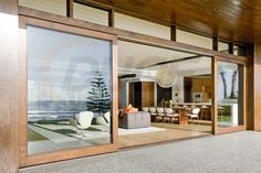 Have a Perfect Exterior Design at Home through Installing Wooden Framed Sliding Patio Doors: Luxurious Beach Residence Exterior With Large Wooden Frame Sliding Glass Doors Honed Concrete, Sliding Glass Door, Door Design, Modern House Design, Modern House, Timber Sliding Doors, Beautiful Homes, Wood Doors Interior, Timber Windows