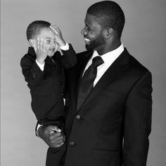 A man and his son (don't even know if he is his, but just to see this is ADORABLE)