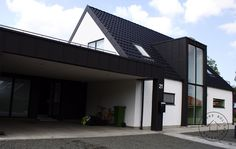 A traditional danish house with a very modern twist. Like it!