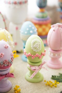 The eggs are very sweet and note also that they are each displayed on their own painted holder.  Too cute  - djc