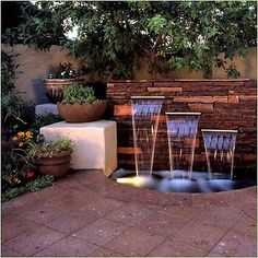 Garden Water Feature with landscape lighting. In Birmingham, AL, get awesome sprinkler service from BlueSkyRain.com and landscape lighting too. #irrigation #garden #Waterfeature