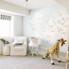 Playroom black and white shade with a world map mural
