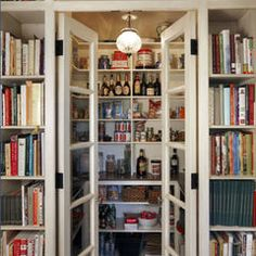 Cookbook shelves outside of french door pantry