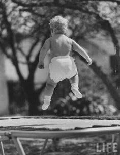 Ralph CRANE :: Baby jumping on a trampoline, 1960 | baby | jump | trampoline | cute | retro | 1960's | www.republicofyou.com.au